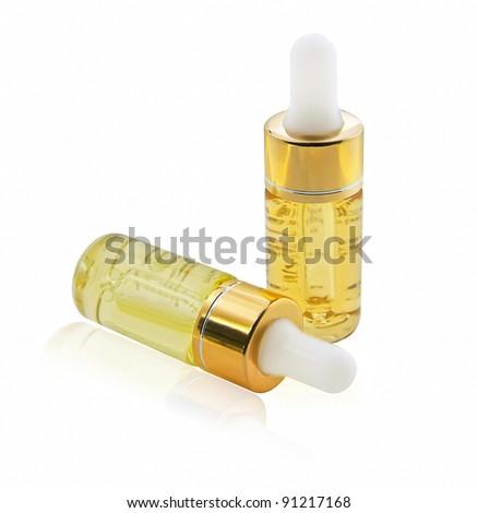 small perfume bottle isolated - stock photo