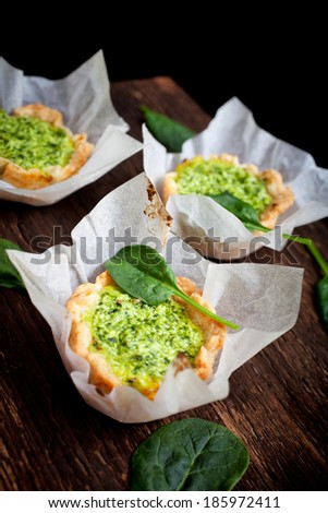 Small pie with spinach and ricotta cheese - stock photo
