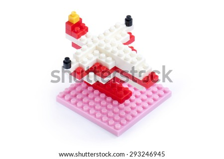 Small pieces colorful plastic jigsaw structure in airplane toy model mock up isolated on white background - stock photo