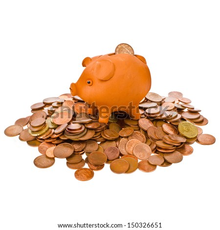 small piggy bank and scattered coins isolated on white background - stock photo