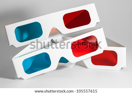 Small pile of anaglyphic cardboard 3D movie glasses.
