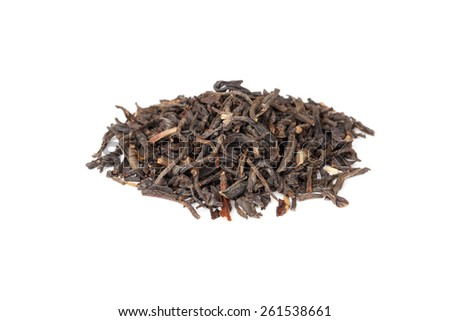 Small pile of big leaf Chinese black tea isolated on white background, selective focus with shallow DOF