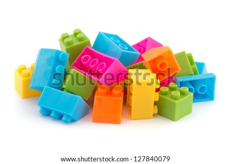 Small pile of colorful childrens building bricks on white - stock photo