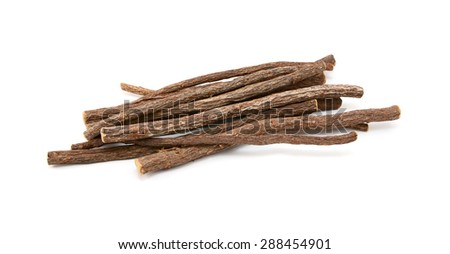 Small pile of liquorice root, isolated on a white background - stock photo