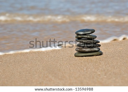 small pile of stones in tower on the beach