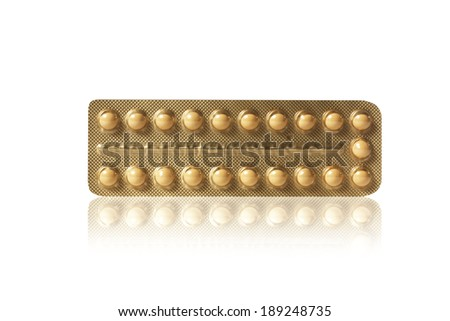 small pills in a blister - stock photo