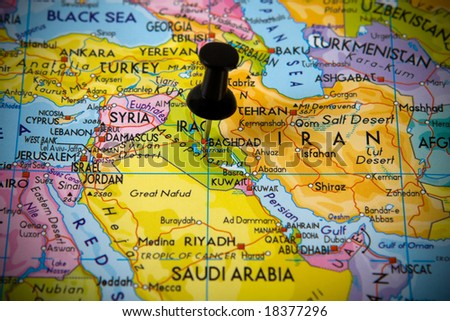 Small pin pointing on Baghdad (Iraq) in map of Near East - stock photo