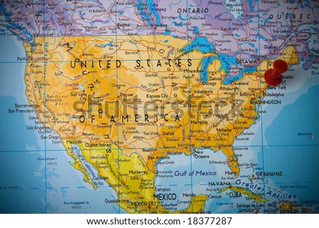 Small pin pointing on New York in map of United States of America - stock photo