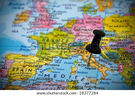 Small pin pointing on Rome (Italy) in a map of Europe - stock photo