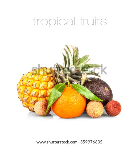 Small pineapple with avocado, lychee and mandarin isolated on white, close up - stock photo