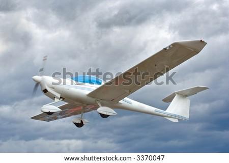 Small plane in flight - stock photo