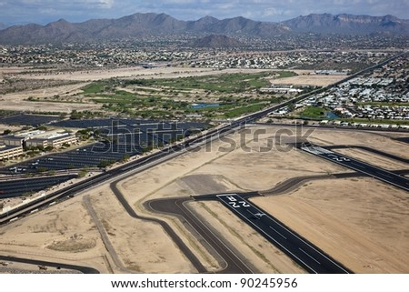 Small plane landing at airport - stock photo