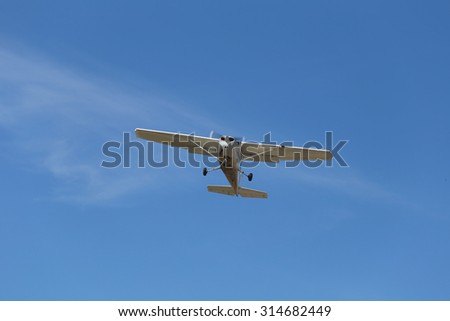 small plane on blue sky in bright day.