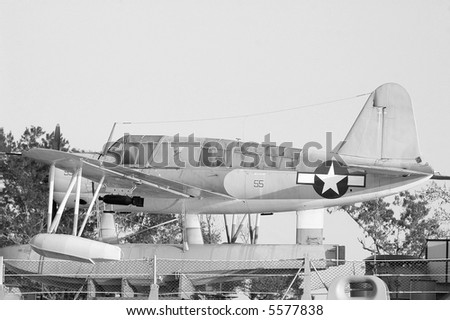 Small plane on the deck of a WWII battleship. - stock photo