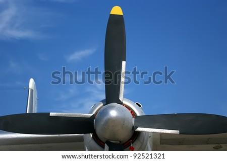 Small plane propeller closeup against blue sky - stock photo