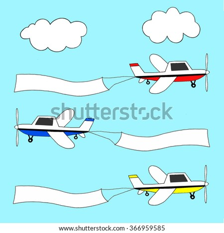 Small planes in three different colors pulling advertising banners. - stock photo