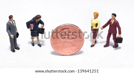 Small plastic people looking at a penny - stock photo