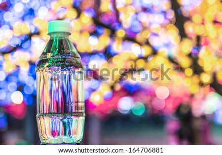 Small plastic water bottle with bokeh background