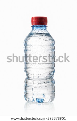 Small plastic water bottle with water drops on white background - stock photo