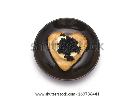 Small Plate with Heart-Shaped Toast with Caviar on White Sauce isolated on white - stock photo