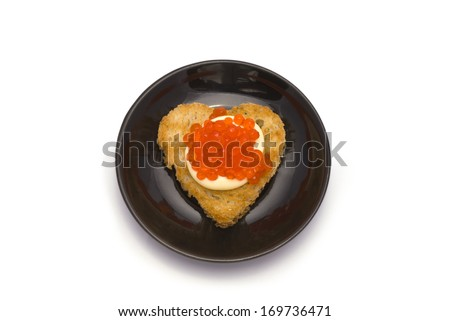 Small Plate with Heart-Shaped Toast with Red Caviar on White Sauce isolated on white - stock photo