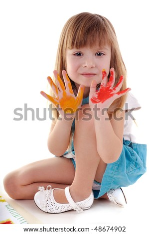 Small playful beauty girl with many-colored hands on white background - stock photo