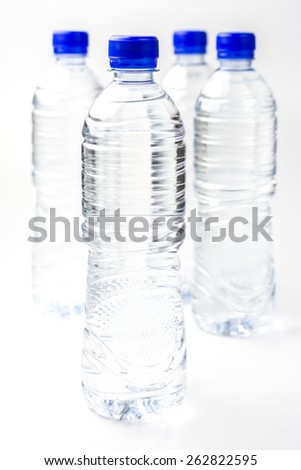 Small polycarbonate plastic bottle of mineral water - stock photo