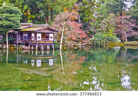 Small pond with old Japanese house in the garden.