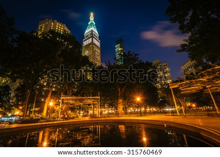 Small pool and buildings at Madison Square Park at night, in Manhattan, New York. - stock photo