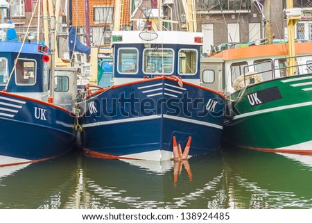 Small port in Urk town - Netherlands. View on fishing boats. - stock photo