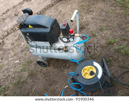 Small portable air compressor for home use - stock photo