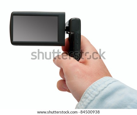 Small Portable Video Camera / Camcorder With Blank Display in Male Hand - Isolated On White - stock photo