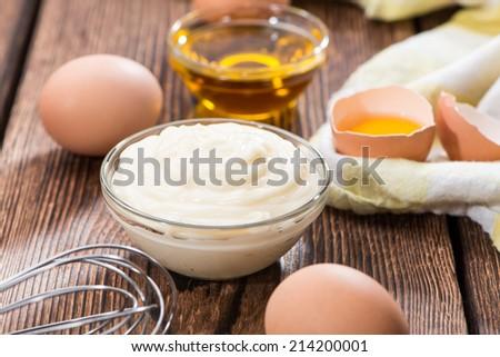 Small portion of fresh homemade Mayonnaise (close-up shot) - stock photo