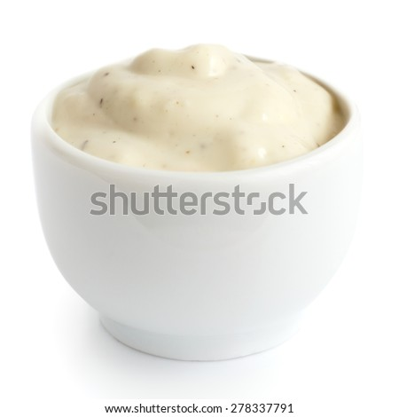 Small pot of garlic mayonnaise dressing, isolated, detail. - stock photo