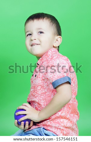 small pretty boy on green background
