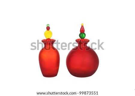 Small pretty colorful red glass bottles - stock photo