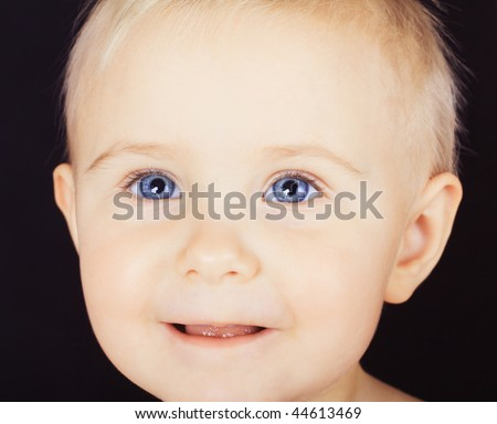 Small pretty girl with blue eyes portrait