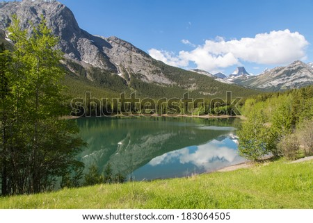 Small pristine lake in Canadian Rockies - stock photo