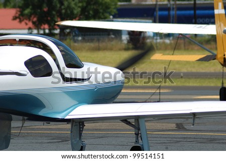 Small private aircraft waiting to take off at a airshow in Oregon - stock photo