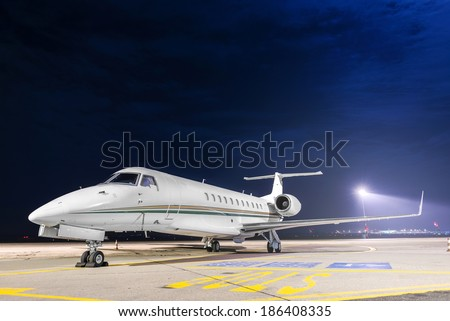 Small private airplane at the airport parking - stock photo