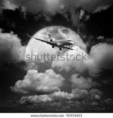 Small private jet aircraft in a night sky. Monochrome, square composition. - stock photo
