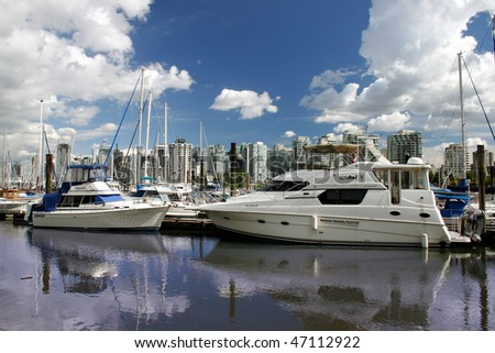 Small private yachts were stopped in the berth near Stanley Park, Vancouver.