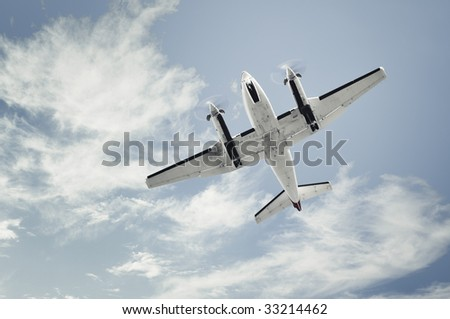 small propeller airplane landing - stock photo