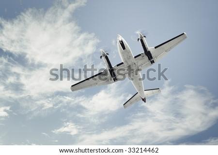 small propeller airplane landing - stock photo