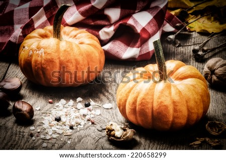Small pumpkins in autumn rustic setting  - stock photo