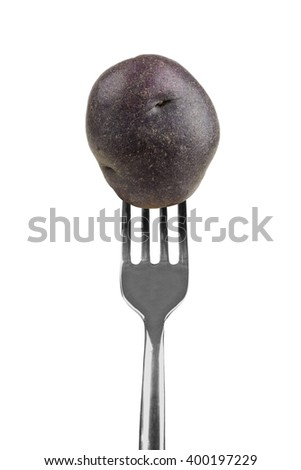 Small purple potato on a fork isolated on a white background