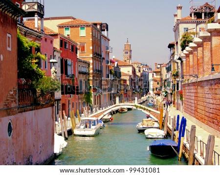 Small quaint canal in the Dorsoduro neighborhood of historic Venice - stock photo