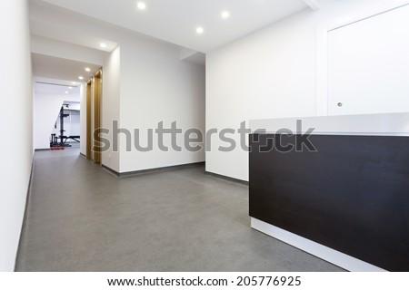 Small reception area with reception desk  - stock photo