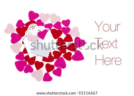 Small red and pink hearts with envelope and empty card, isolated on white, copy space