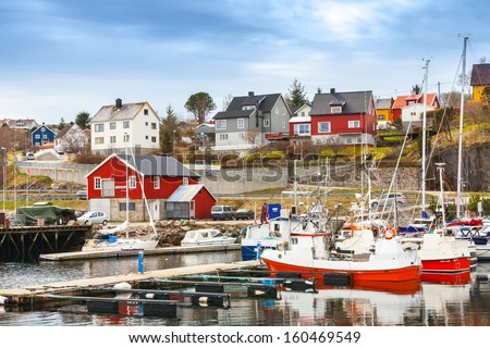 Small red and white fishing boats stand moored in Norway fishing town Rorvik - stock photo